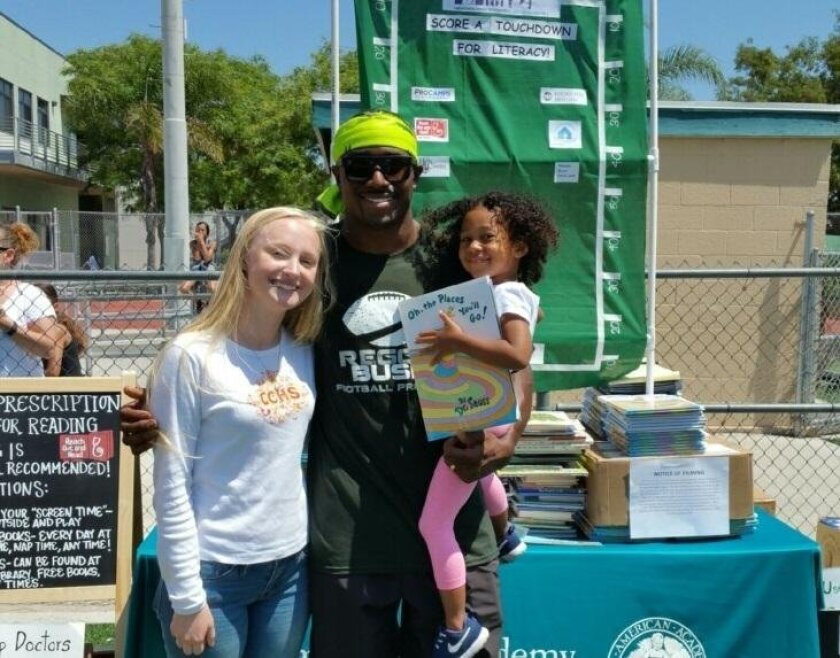 "Sarah Lackey, Reggie Bush and a ""big"" Dr. Seuss fan!"