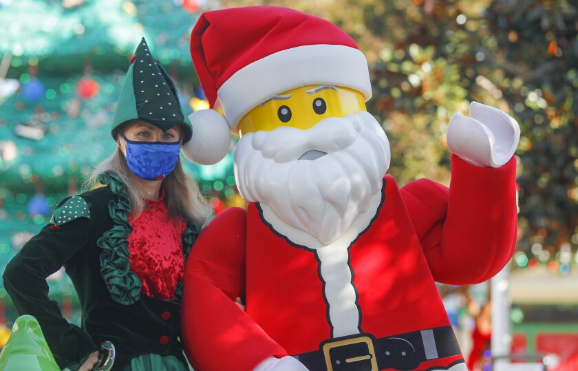 Lego Santa and elf pose for photos as a preview to the Holidays at Legoland event.