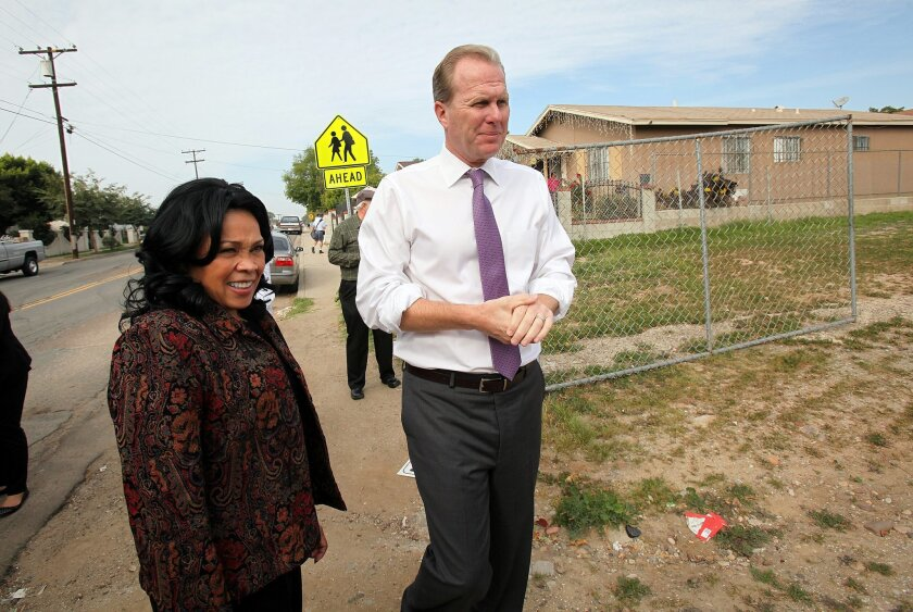 City Council member Myrtle Cole and Mayor Kevin Faulconer took business representatives, government officials and civic leaders on a bus tour through southeastern San Diego neighborhoods Thursday to show the area is ripe for development and commercial opportunities.