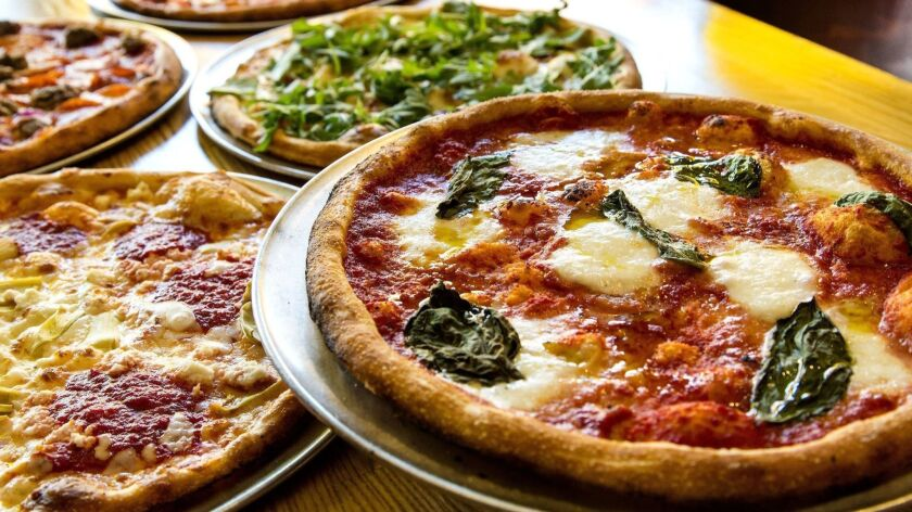 Personal 11-inch pizzas are the mainstay of Blaze Pizza's menu. The chain is branching out, offering 14-inch pizzas for delivery.