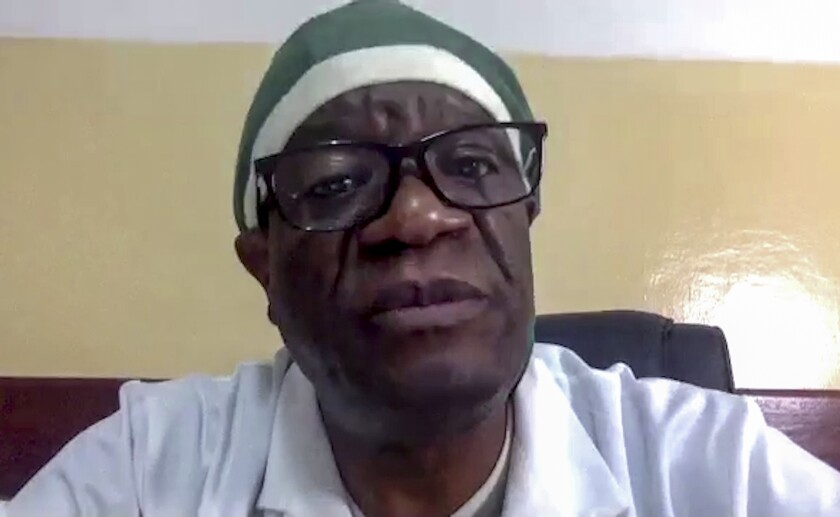 This image made from video shows Congolese Nobel Peace Prize winner Dr. Denis Mukwege at the Panzi Hospital he founded in Bukavu in eastern Congo, to treat survivors of sexual violence, being interviewed by The Associated Press by video call from Dakar, Senegal Thursday, Oct. 1, 2020. Mukwege says mass atrocities, including widespread sexual violence, continue to go unpunished in his country and an international criminal tribunal is urgently needed to prosecute those crimes. (AP Photo/Yesica Fisch)