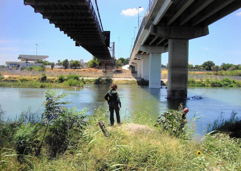Border Patrol Agent Erica Sanchez, 33, searches for immigrants on the banks of the Rio Grande near Roma, Texas.