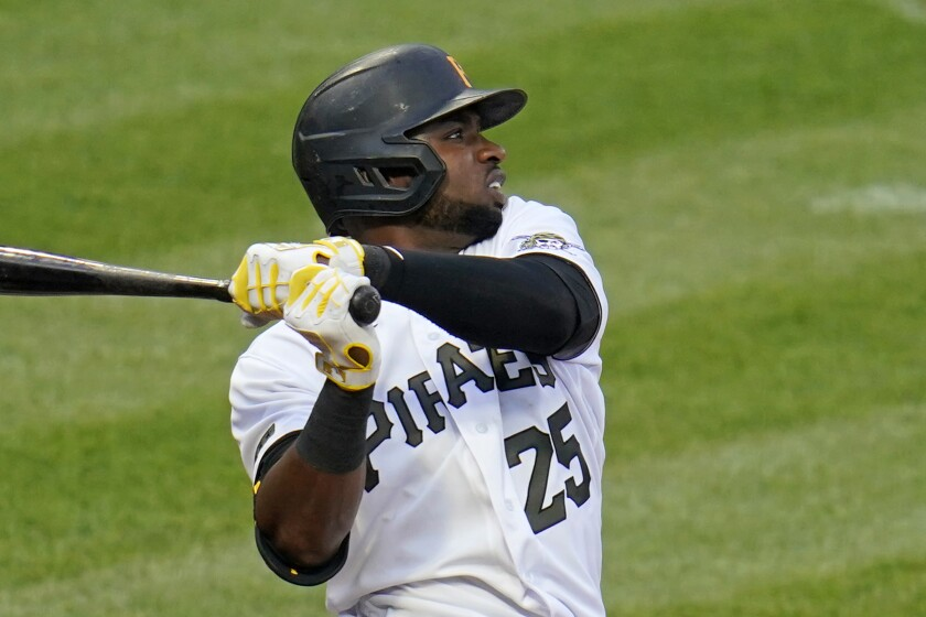 Pittsburgh Pirates' Gregory Polanco watches his solo home run off San Diego Padres starting pitcher Joe Musgrove (44) during the second inning of a baseball game in Pittsburgh, Wednesday, April 14, 2021. (AP Photo/Gene J. Puskar)
