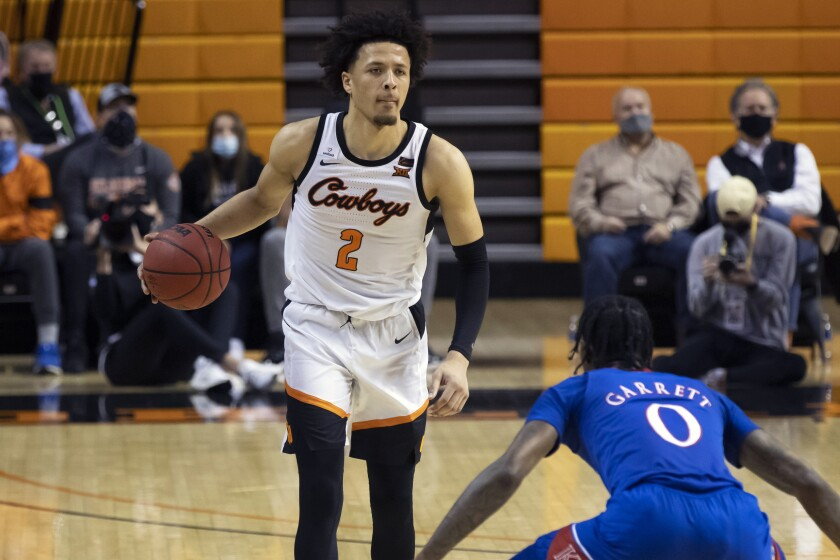 Oklahoma State's Cade Cunningham brings the ball up the court during the second half against Kansas.