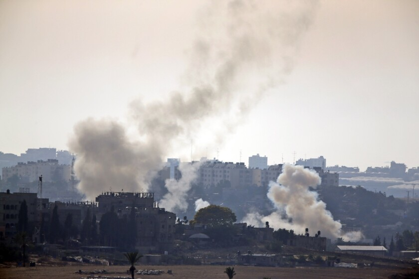 Smoke rises after Palestinian militants launched several rockets towards Israel on July 12.