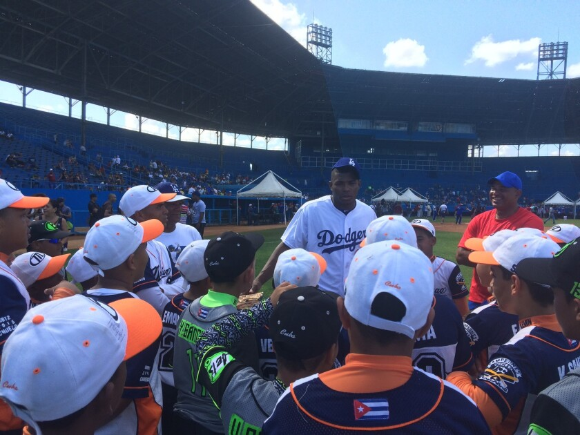 Dodgers outfielder Yasiel Puig talks to Cuban players at Estadio Latinoamericano during a MLB goodwill tour.