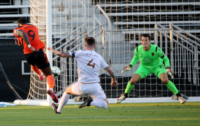 "Orange County Soccer Club forward Sean ""Ugo"" Okoli scores a goal in the first half of against the Phoenix Rising."