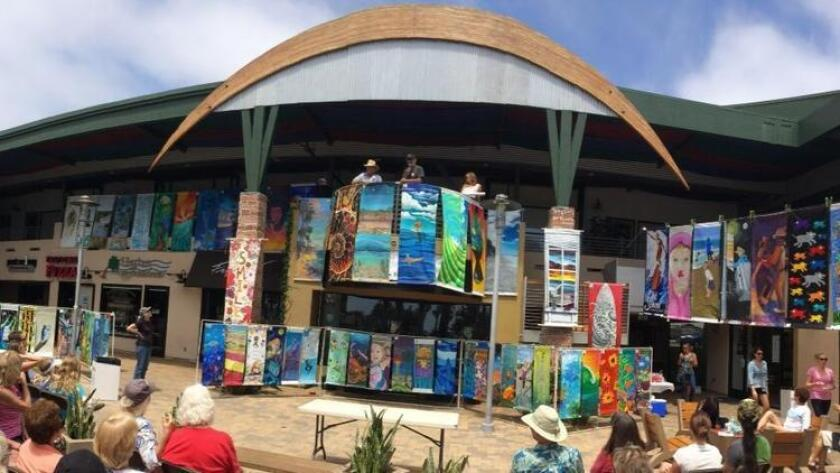 Arts Alive Banners will be auctioned off May 21 in Cardiff. Pictured is last year's auction in Encinitas. (Courtesy photo)