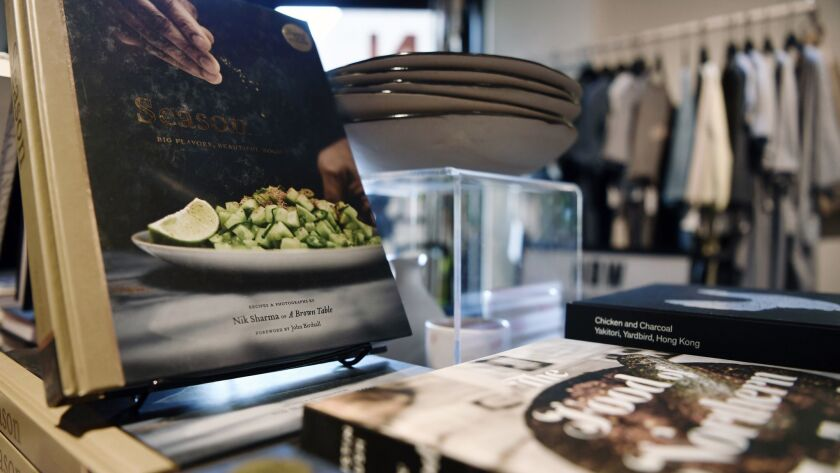 Recently published cookbooks pair with ceramics and chef gear at Now Serving in Chinatown.