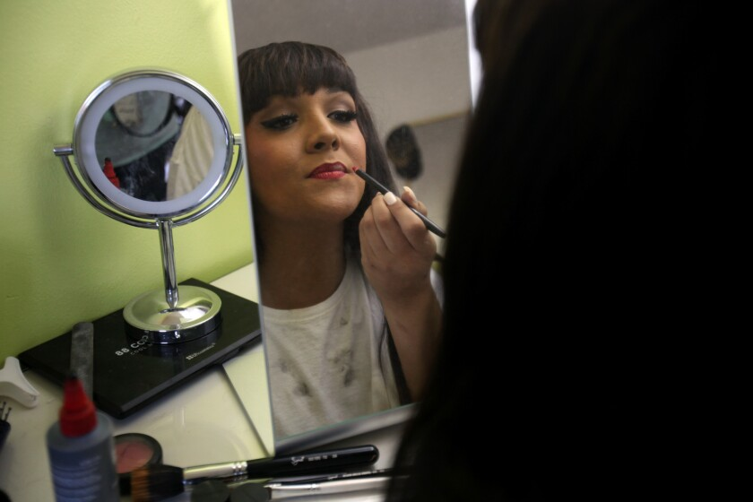 Cassidy Lynn Campbell puts on her makeup before attending Homecoming at Marina High School in Huntington Beach last September. Cassidy, a transgender student, was crowned Homecoming queen that night.