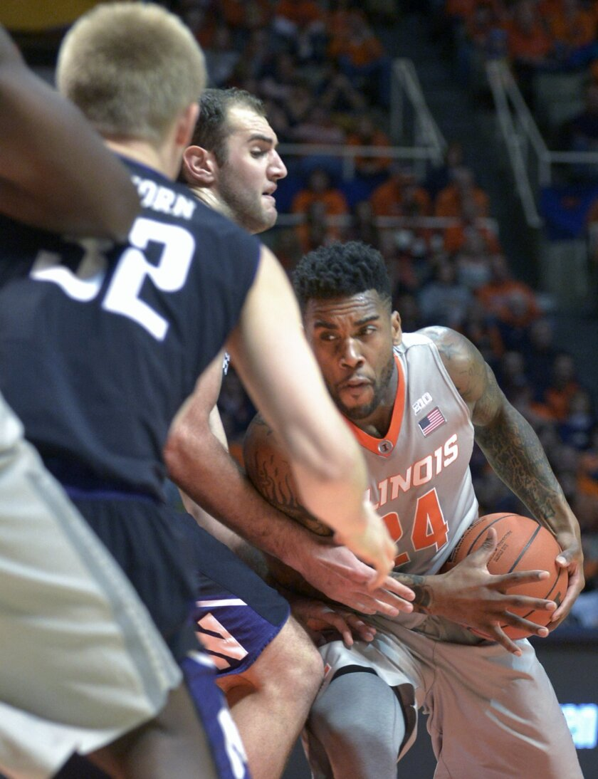 Illinois' guard Rayvonte Rice (24) drives on Northwestern's center Alex Olah (22) and Northwestern's forward Nathan Taphorn (32) during an NCAA college basketball game in Champaign, Ill., Saturday, Feb. 28, 2014. (AP Photo/Robin Scholz)