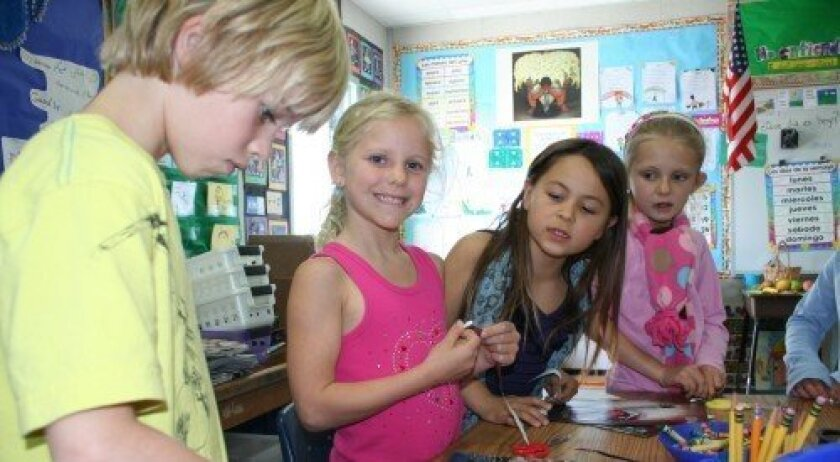 Del Mar Heights second-graders make necklaces for Positive Community Impact's Walk for Water project. Photo: Karen Billing