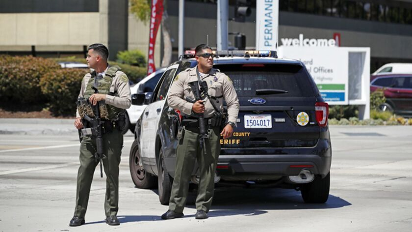 Los Angeles County Sheriff's deputies stand outside after staff and patients were evacuated from Kai