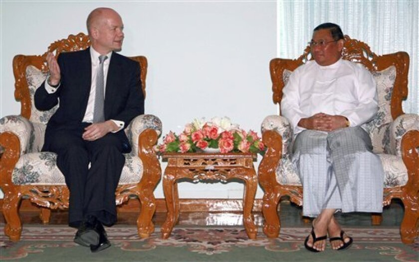 British Foreign Secretary William Hague, left, gestures while talking with his Myanmar counterpart Wunna Maung Lwin during their meeting Thursday, Jan. 5, 2012 in Naypyitaw, Myanmar. Hague began a two-day visit to Myanmar Thursday. (AP Photo/Apichart Weerawong)