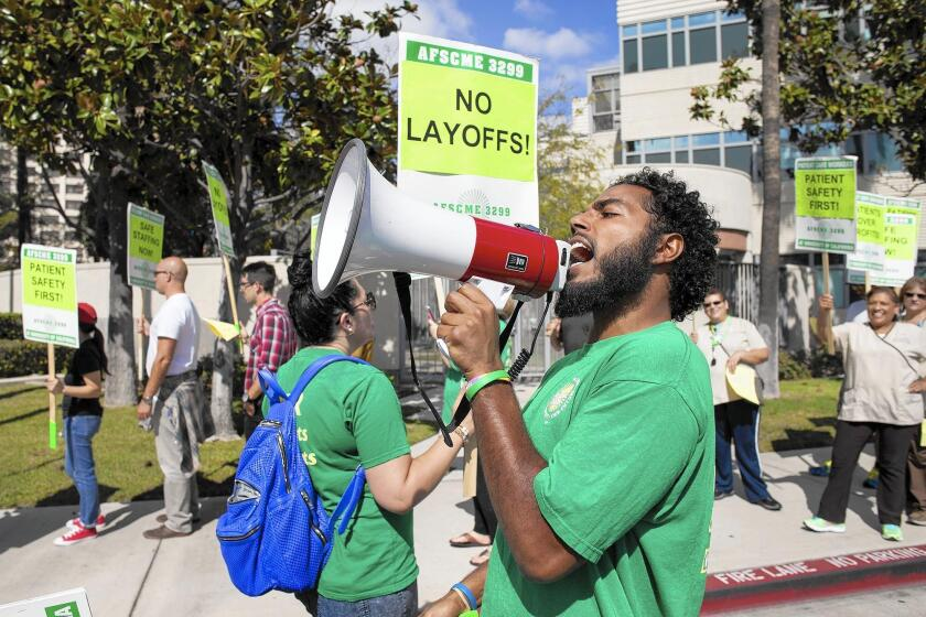 UC Irvine Health workers picket medical center over layoffs - Los