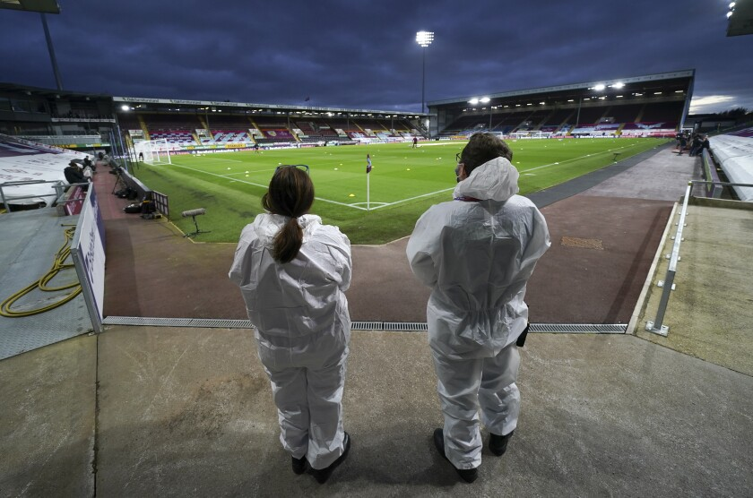 Medical staff stand on the field ahead of the English Premier League soccer match between Burnley and Southampton at Turf Moor in Burnley, England, Saturday, Sept. 26, 2020. (Jon Super/Pool via AP)