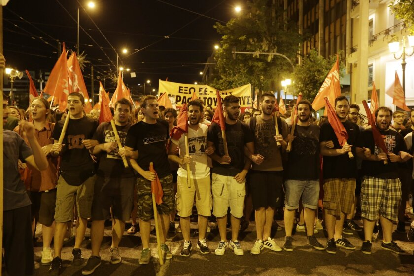 """Supporters of the """"No"""" vote on austerity, which ultimately won, shout slogans during a protest in Athens on July 5, 2015."""