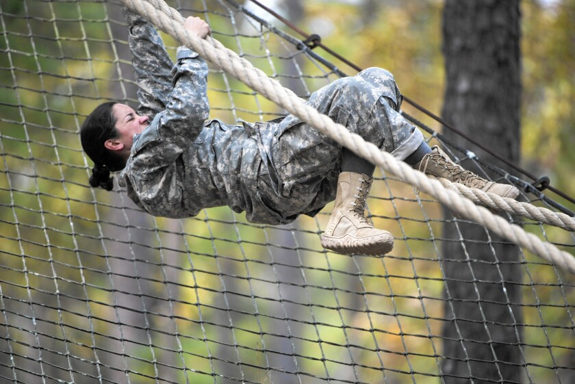Army 1st Lt. Alessandra Kirby makes her way through an obstacle course at Ft. Benning, Ga. Kirby is among about 60 women who will participate in the Army Ranger course assessment in April.