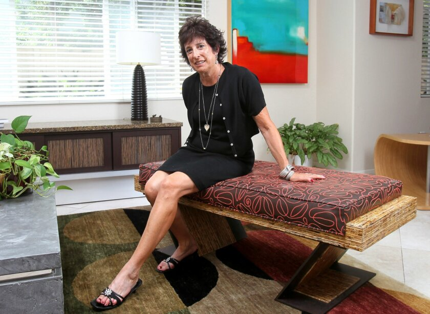 Del Mar furniture designer Laura Birns sits on her favorite item, the Tzumba bench. It's made of pressed wood, faux leather and steel scrap metal.