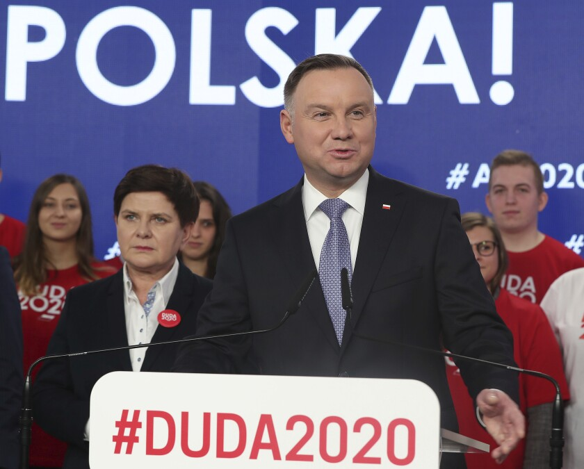 FILE - In this Feb. 19, 2020 file photo, Poland's President Andrzej Duda campaigns for his re-election in Warsaw, Poland. Poland's parliament speaker says the postponed presidential election will take place June 28. The election was originally planned for May 10 but the coronavirus pandemic forced the conservative government to put it off. (AP Photo/Czarek Sokolowski, File)