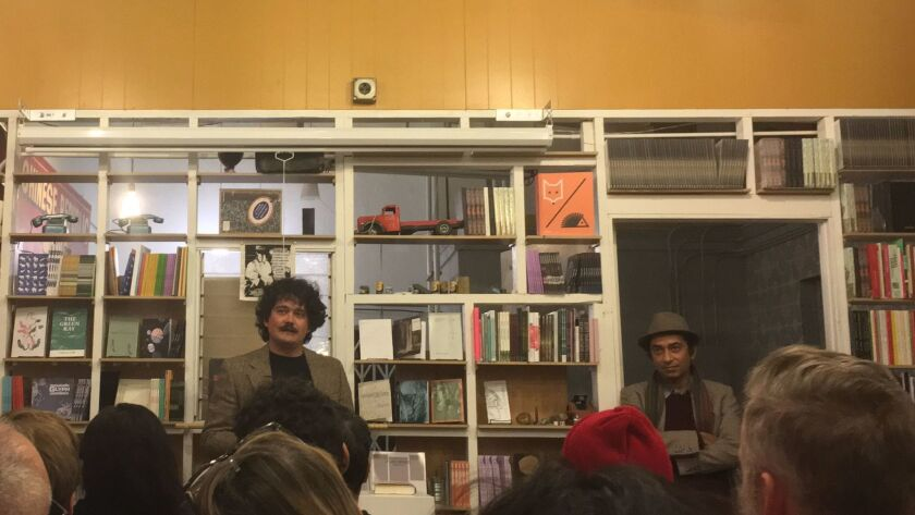 David Shook, left, introduces Emadi Mohsen at The Poetic Research Bureau.