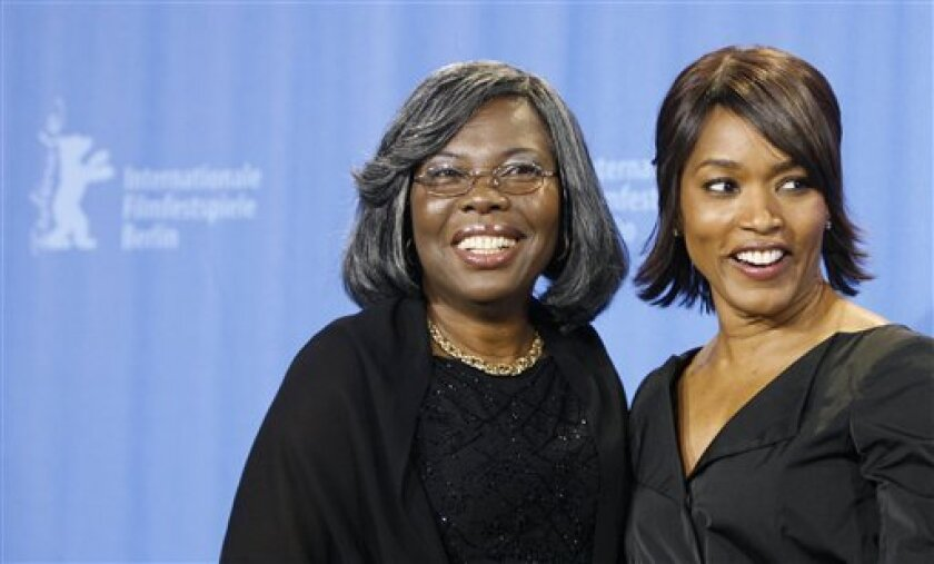 """U.S. actress Angela Bassett, right, and the mother of late Rapper Notorious BIG Voletta Wallace pose during a photo call for the movie """"Notorious"""" at the Berlinale in Berlin, on Wednesday, Feb. 11, 2009. The 59th International Film Festival takes place in the German capital from Feb. 5 until Feb. 15, 2009. (AP Photo/Markus Schreiber)"""