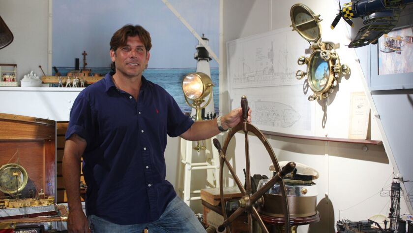 A ship's wheel and porthole inside the Nautical History Gallery & Museum make guests feel like they are on a boat. Pictured: Joe Frangiosa.
