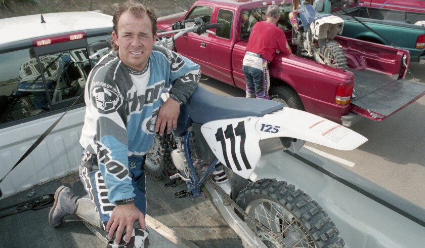 Motocross champion Marty Smith packs up equipment after a ride overlooking Otay Valley on Nov. 14, 1996.