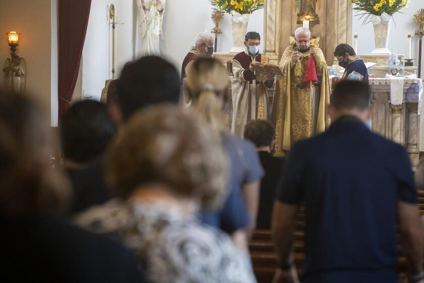 Father Armenag Bedrossian leads a Sunday service