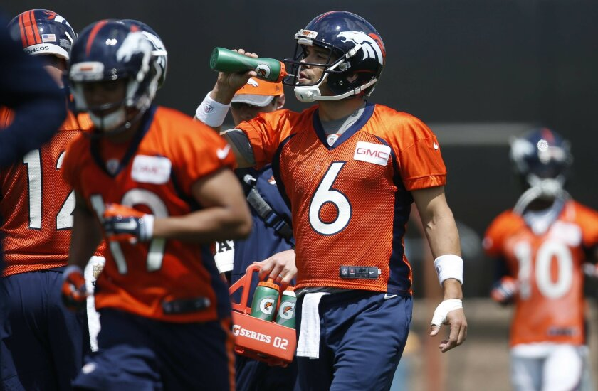 Denver Broncos quarterback Mark Sanchez drinks water during NFL football practice Tuesday, May 31, 2016, at the team's headquarters in Englewood, Colo. (AP Photo/David Zalubowski)