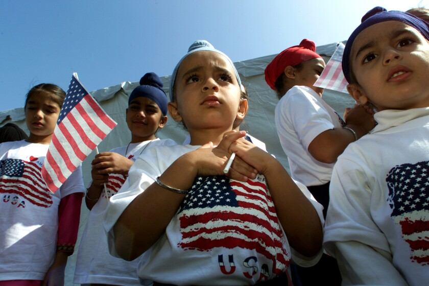 Harnadar Singh, 4, center, and other children prepare to say the Pledge of Allegiance on Oct. 10, 2001, at the Sikh Temple of Orange County in Santa Ana, at a ceremony to remember the victims of terrorist attacks.