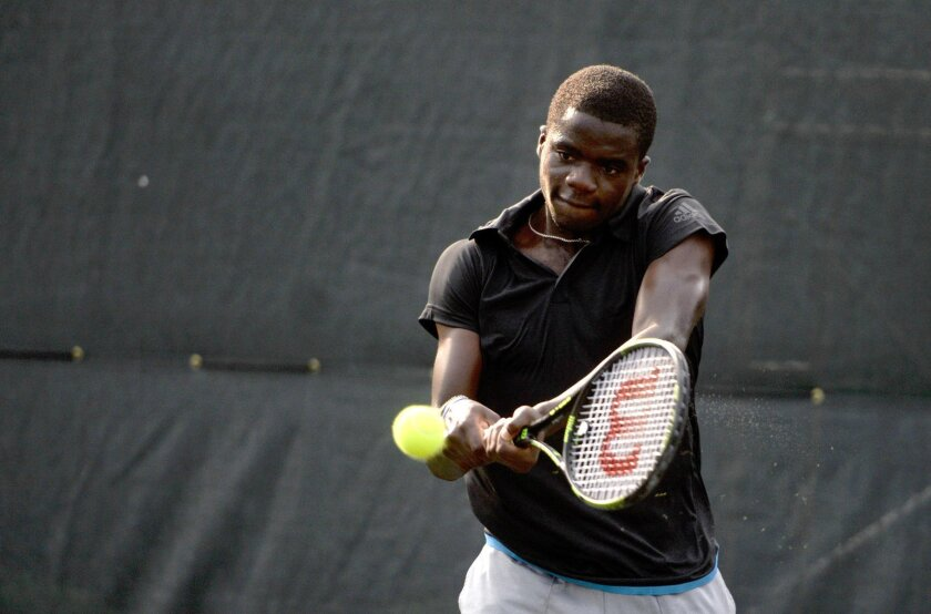 FILE - In this April 25, 2015, file photo, Frances Tiafoe, of the United States, returns a serve from James McGee, of Ireland, during the semifinals of the St. Joseph's/Candler Savannah Challenger tennis tournament in Savannah, Ga.  Tiafoe is among a new generation on the way in the men's game and