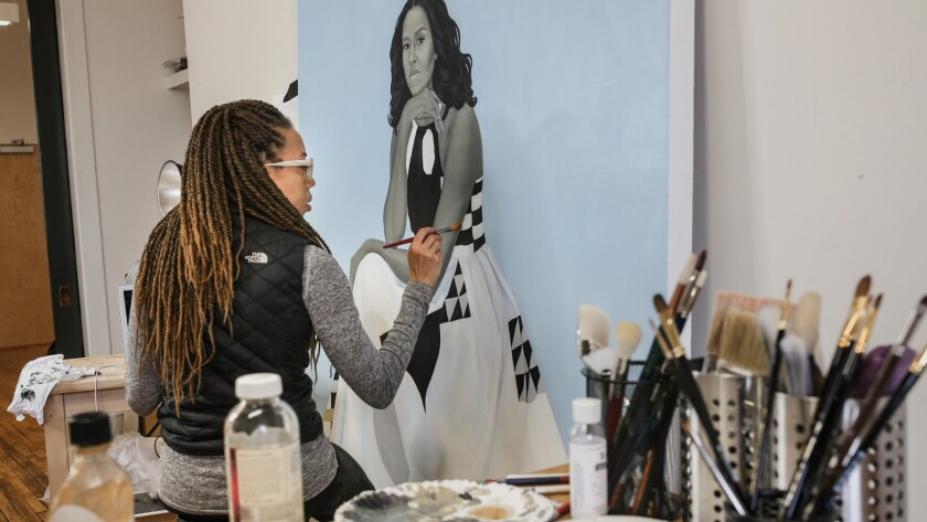 Amy Sherald is shown painting her portrait of Michelle Obama.