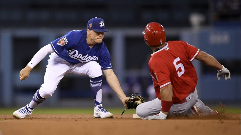 Los Angeles Dodgers second baseman Enrique Hernandez, left, tags out Albert Pujols at second on March 26.
