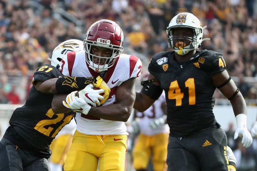USC running back Kenan Christon (23) runs with the football en route to scoring on a 58-yard touchdown reception ahead of Arizona State defensive back Jack Jones (21) and defensive lineman Tyler Johnson (41) during the first half on Saturday in Tempe, Ariz.