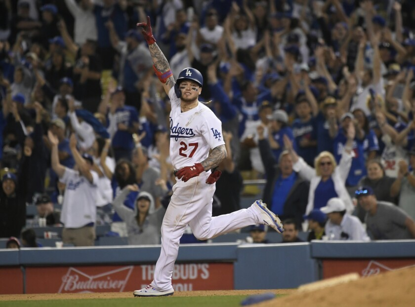 Dodgers outfielder Alex Verdugo celebrates after hitting a walk-off home run against the Colorado Rockies at Dodger Stadium on June 22.