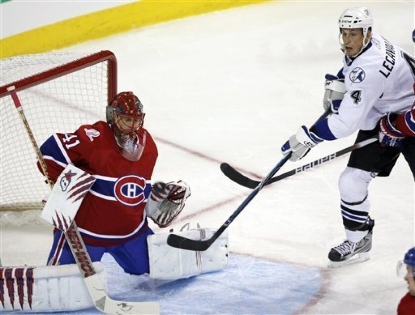 Montreal Canadiens goaltender Jarolsav Halak, of Slovakia, makes the save on Tampa Bay Lightning's Vincent LeCavalier during second period NHL ice hockey action Tuesday, March 9, 2010 in Montreal. (AP Photo/The Canadian Press,Ryan Remiorz)