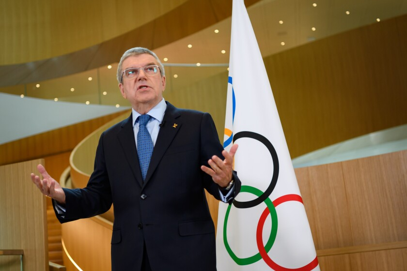 IOC President Thomas Bach speaks to reporters in March.