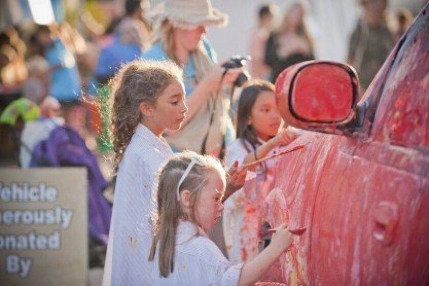 Children paint a car during last year's La Jolla Art and Wine Festival. Courtesy