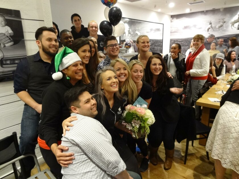 Maeve Rochford (center) shares her baking championship victory with the Sugar and Scribe staff.