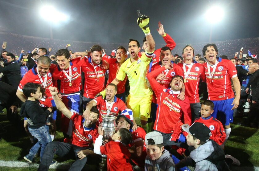 Chile's players celebrate with the Copa America trophy after defeating Argentina in the final soccer match at the National Stadium in Santiago, Chile, Saturday, July 4, 2015. Chile became Copa America champions for the first time after defeating Argentina in a penalty shootout. (AP Photo/Luis Hidal