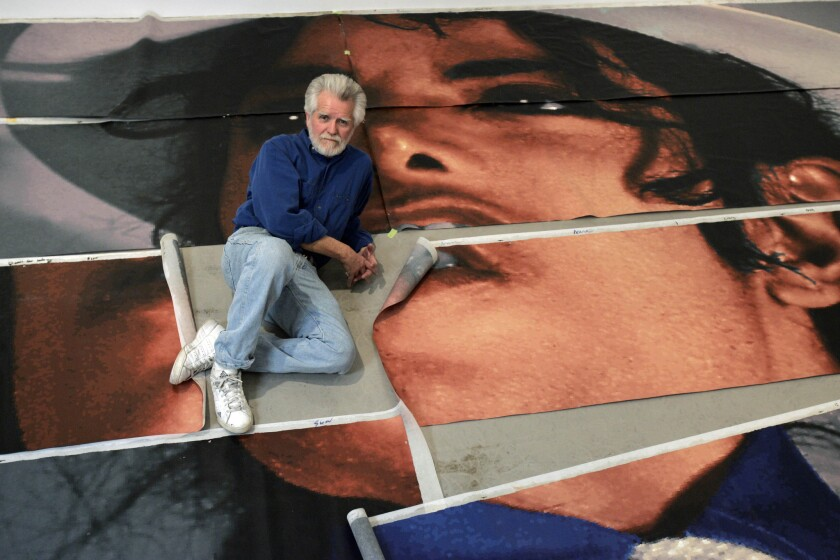 In this 2009 photo, artist Kent Twitchell sits with panels that make up his Michael Jackson mural. The Museum of the San Fernando Valley will debut an exhibit Friday displaying elements of the little-seen 10-story-tall mural.