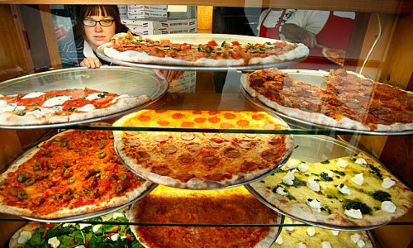 The pizzas on display at Vito's Pizzeria on La Cienega Boulevard in Los Angeles.