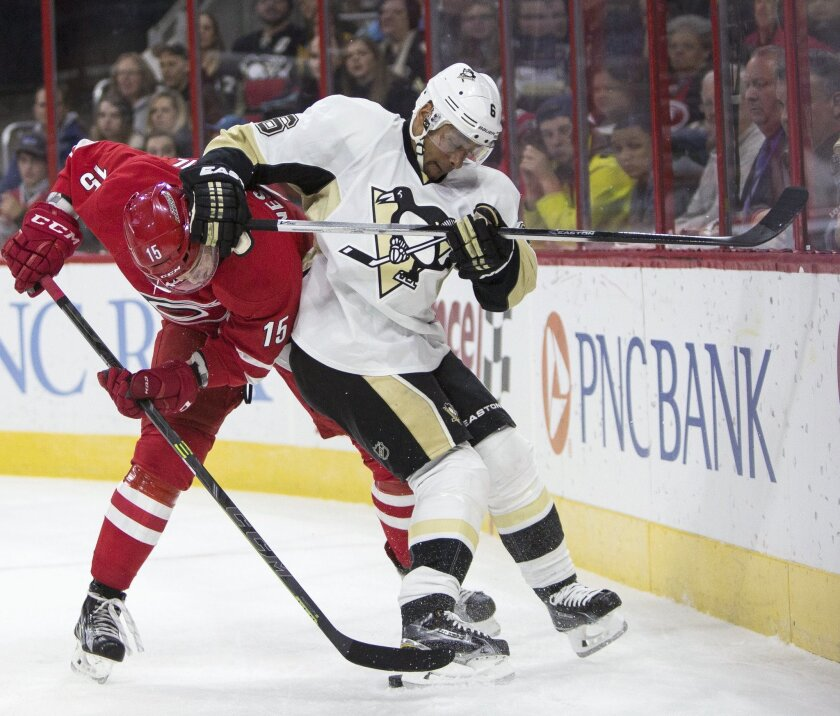 Pittsburgh Penguins' Trevor Daley (6) and Carolina Hurricanes' Andrej Nestrasil (15), of the Czech Republic, vie for the puck during the first period of an NHL hockey game in Raleigh, N.C., Friday, Feb. 12, 2016. (AP Photo/Ben McKeown)