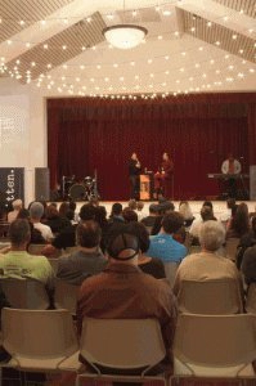 The Cuvier Club is full of people who want to hear Christian Hosoi's story.