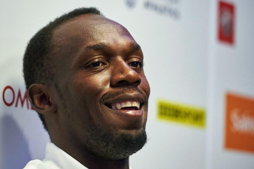 Jamaican sprinter Usain Bolt attends a news conference Thursday in London ahead of an IAAF Diamond League London event.