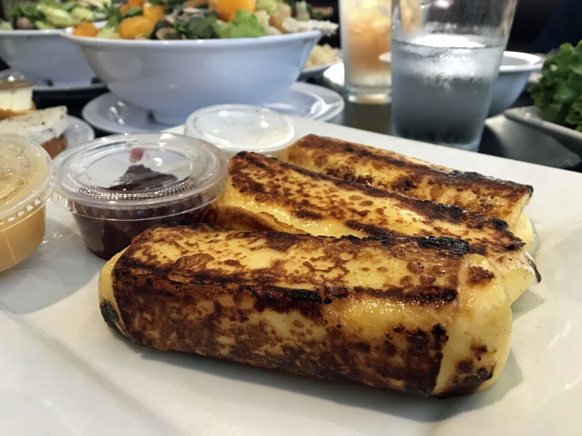 The cheese blintzes from Lenny's Deli. (Jenn Harris / Los Angeles Times)