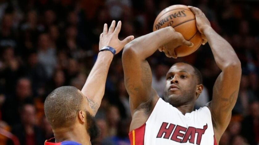Heat guard Dion Waiters shoots over Pistons forward Marcus Morris during a game on Jan. 28.