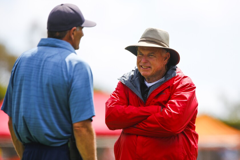 Event organizer Dennis McClanahan talks with a CIF official during his last meet before retirement.