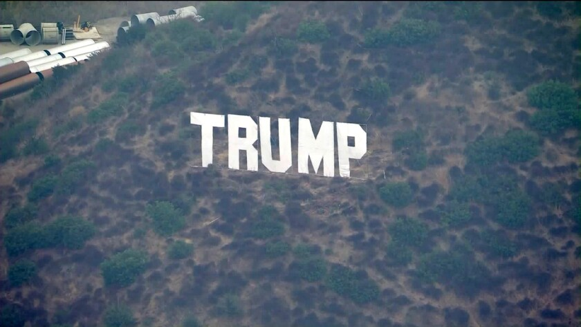 """A """"Trump"""" sign on the hills along the 405 Freeway in the Sepulveda Pass."""